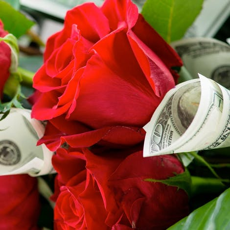 A bouquet of roses mingling with cash