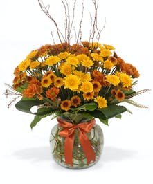 Glass cache vase with mums