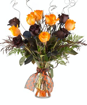 Halloween colored arrangement in glass vase