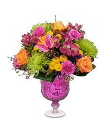 "Bright and wonderful arrangement in 8"" fuchsia mercury glass pedestal vase"