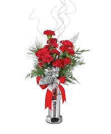 Giant silver bolt and nut with carnations and christmas greens