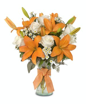 Lilies and Roses in a gathering vase