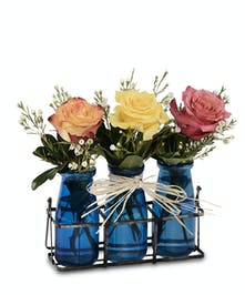 Three cobalt blue vases with Roses