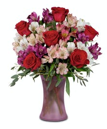 Alstromeria in frosted magenta vase with roses