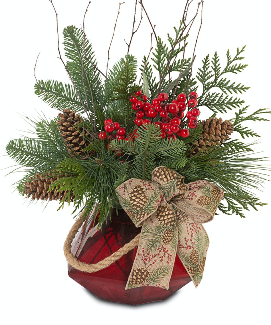 Fresh Christmas greens in rudy red, glass vase