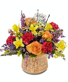 February birthday arrangement in gold vase with bright flower mix