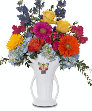 Bright bouquet in heirloom vase