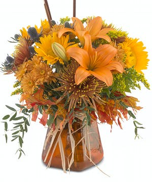 Tapered glass vase with holiday mix