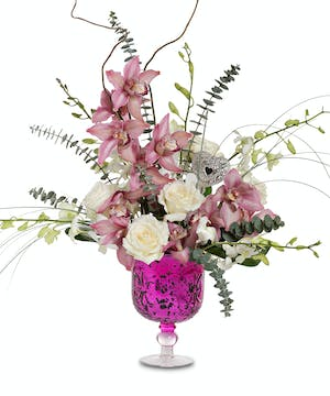 Orchids in hot pink pedestal vase