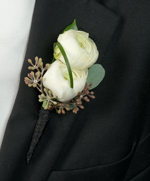 Boutonniere with white Ranunculus
