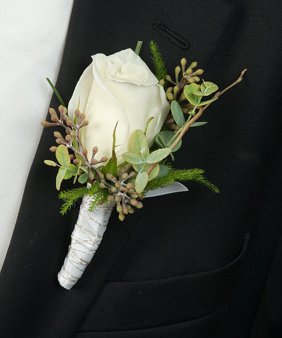 About White Rose Boutonniere From Walter Knoll Florist In Saint