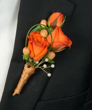 Boutonniere with sweetheart roses and berries