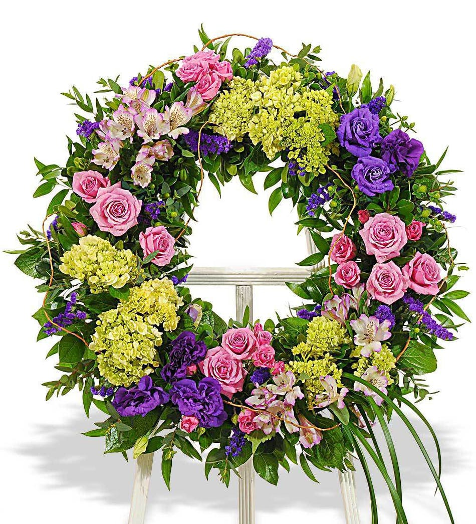 About Bold Mix Wreath On White Wood Easel From Walter Knoll Florist