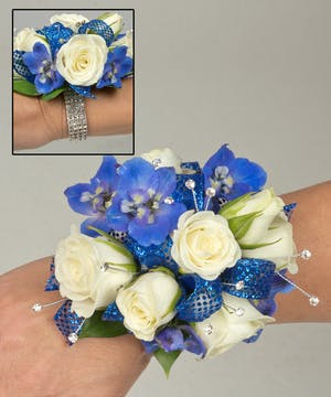 Corsage with sweetheart roses and delphinium blooms