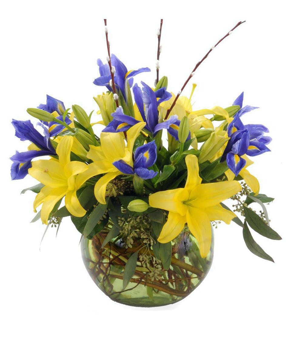 About creekside a spring arrangement of yellow and purple from walter knoll florist creekside bouquet izmirmasajfo