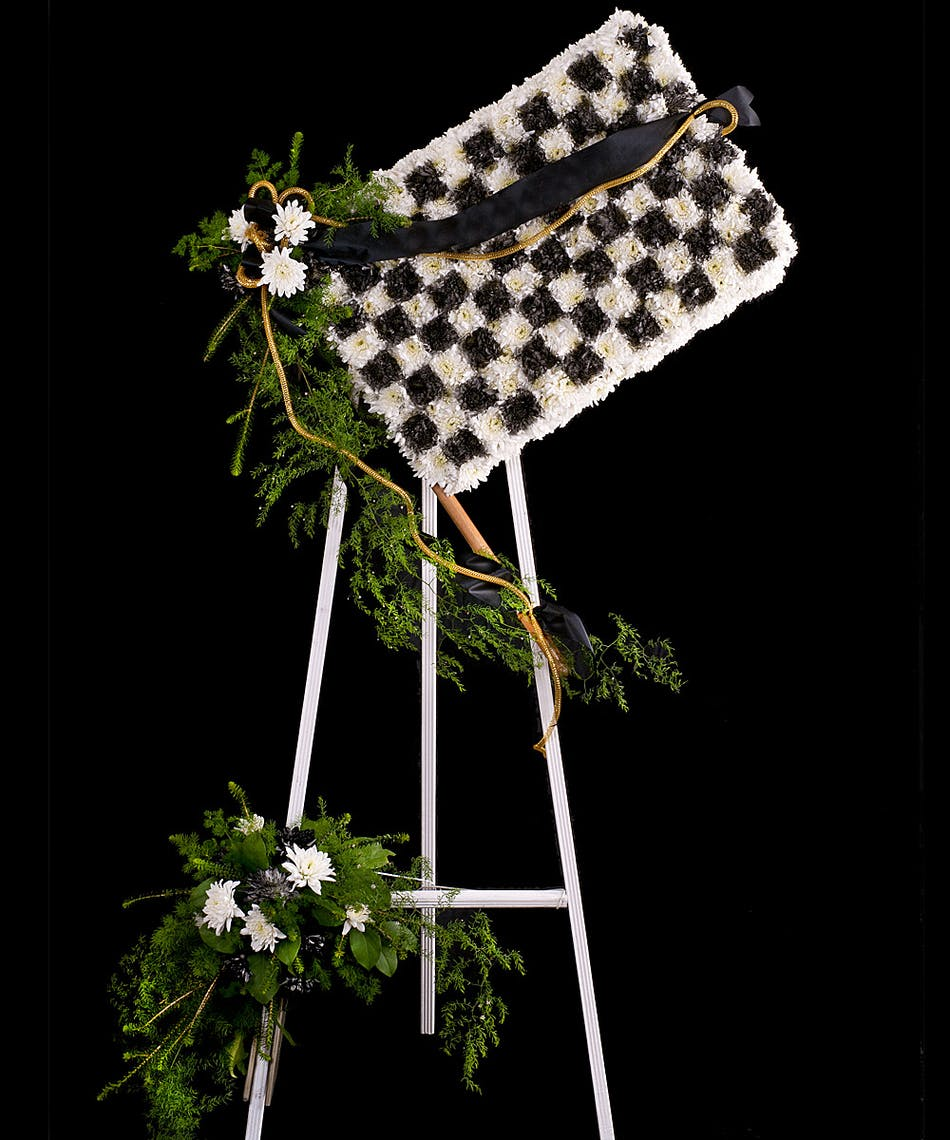 A tribute display of fresh flowers made into a racing checkered flag izmirmasajfo