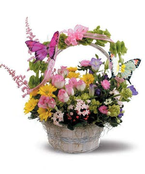 White basket filled with flowers and butterflies.