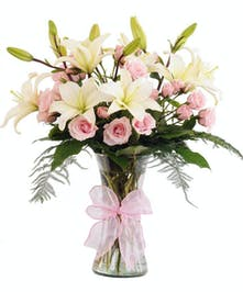 Ivory lilies with pink spray roses