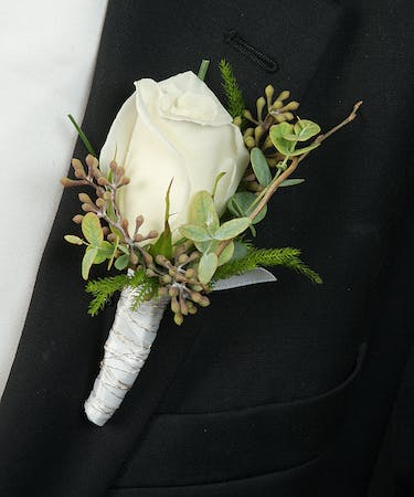 About White Rose Boutonniere From Walter Knoll Florist In