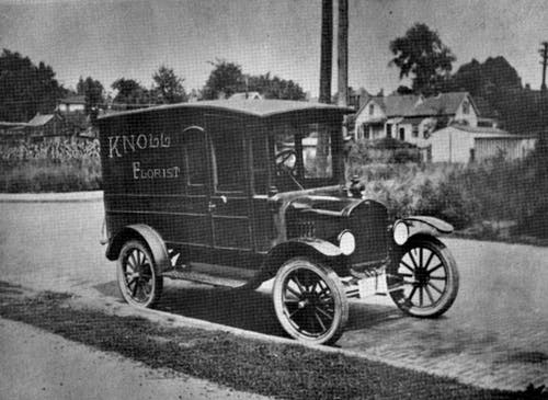 One of Knoll Florists' first delivery vehicle, a painted truck, near the turn of the century